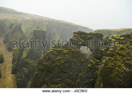 View of arch rock formation and canyons at Fjadrargljufur, Iceland - Stock Photo