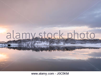 Snow covered landscape view at Lake Ellidavatn, Iceland - Stock Photo