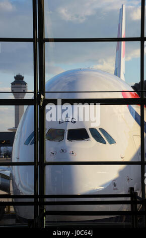British Airways Airbus A380 on the gate at Dulles International Airport in Washington with control tower in the - Stock Photo