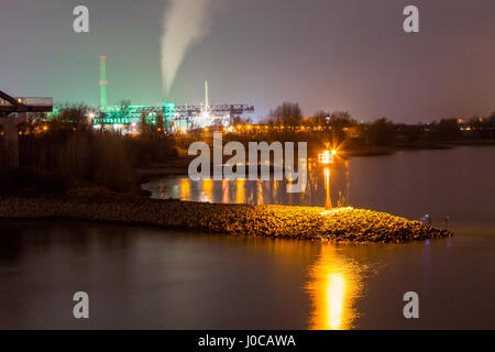 Power plant Lausward at night in Dusseldorf Media Harbor, Germany - Stock Photo