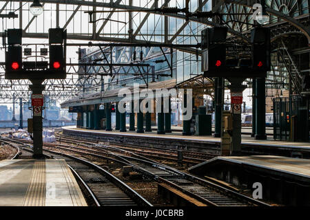 Glasgow central railway station with platforms and rail lines, also showing red light, Glasgow, Scotland, UK - Stock Photo
