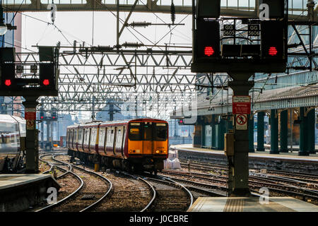 Train approaching a platform at Glasgow Central railway station, Glasgow, Scotland, UK - Stock Photo