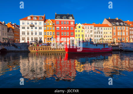 COPENHAGEN, DENMARK - MARCH 11, 2017: Copenhagen Nyhavn district. Nyhavn was constructed by King Christian V from - Stock Photo