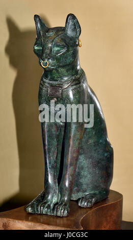 The Gayer-Anderson Cat Bronze figure of a seated cat inlaid silver sun-disc and wedjat-eye pectoral on the chest - Stock Photo