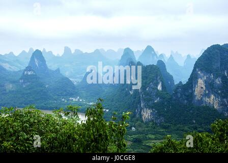 Karst mountains landscape in the mist, Guilin, China. - Stock Photo