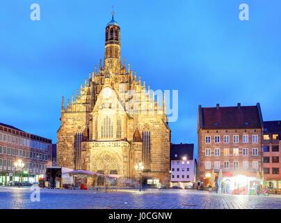Nuremberg, cathedral Frauenkirche in Hauptmarkt wtih rainbow, Bavaria, Germany - Stock Photo