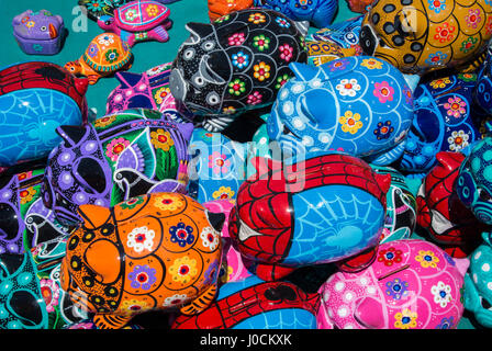 Colourful cermaic pots in the shape of animals on sale in the street, Mexico City - Stock Photo
