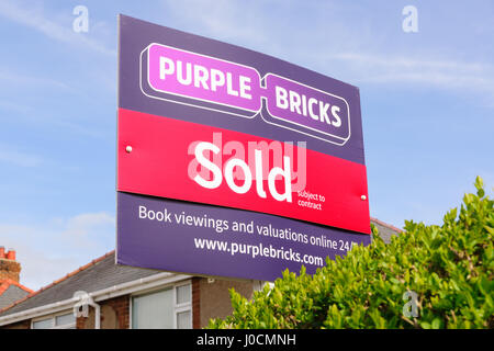Purple Bricks Group PLC estate agents sold sign the company is the UKs first online property agent launched in 2014 - Stock Photo