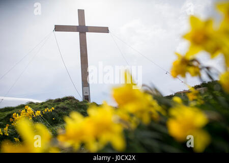Otley, UK. 11th April 2017. The Easter Cross set high on Surprise View  at Otley Chevin near Leeds in West Yorkshire. - Stock Photo