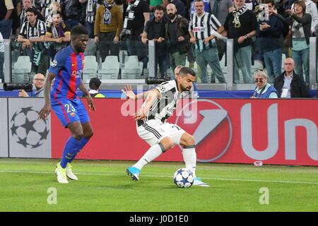 Turin, Italy. 11th Apr, 2017. Samuel Umtiti (FCB Barcelona) and Tomas Rincon (Juventus FC) during the 1st leg of - Stock Photo