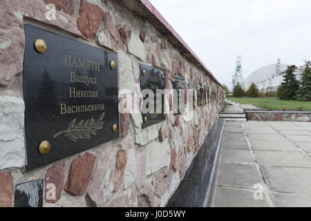Cernobyl, Ukraine. 10th Apr, 2017. Monument to the victims of the Chernobyl tragedy outside the nuclear power plant - Stock Photo