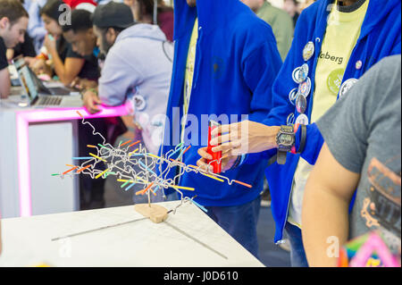 Participants at the Bloomberg booth at a Career Expo held at the FIRST Robotics NYC Championship at the Fort Washington - Stock Photo