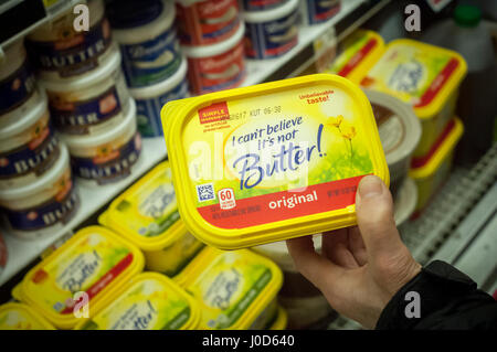 Tubs of I Can't Believe It's Not Butter and other Unilever spreads in a supermarket cooler on Saturday, April 8, - Stock Photo