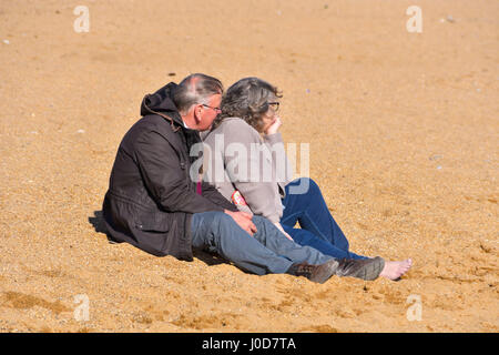 West Bay, Dorset, UK. 12th Apr, 2017. UK Weather. Holidaymakers enjoy late afternoon sunshine on the beach at the - Stock Photo