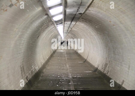 London, UK. 12th Apr, 2017. London, United Kingdom - April 12: People seen walking through the Greenwich foot tunnel - Stock Photo