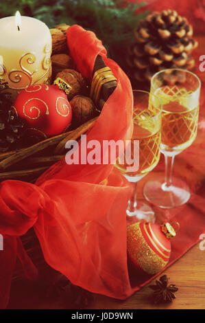 basket with christmas decoration and two champagne glasses. - Stock Photo
