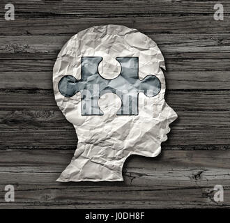 Childhood education or mental disorder in the brain of a child as epilepsy add or adhd or autism symbol as a crumpled - Stock Photo