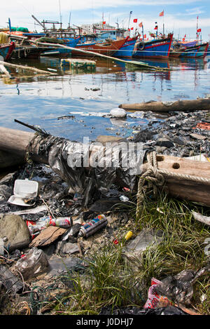 Vertical view of rubbish washed up on the riverbank in Da Nang, Vietnam - Stock Photo