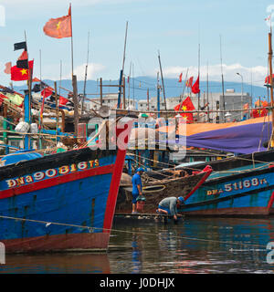 Square view of old wooden fishing boats in Da Nang, Vietnam - Stock Photo
