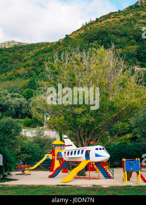 Children's playground with slides and swings. Children's slide i - Stock Photo