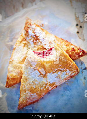 Blueberry puff pastry on white summer table - Stock Photo