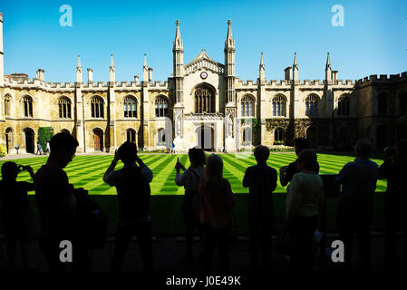 amazing silhouette of people visiting corpus christi college in cambridge, with a view across the new court in the - Stock Photo