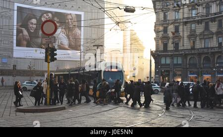 busy street corner in Milan in evening sunlight - Stock Photo