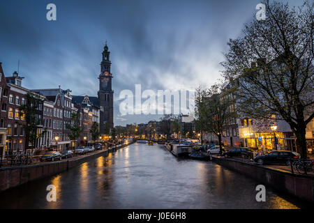 view of an Amsterdam canal in the district of Joordan with The Church of the West - Stock Photo