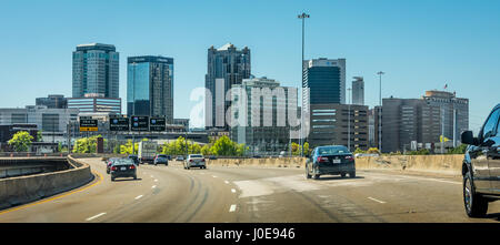 Birmingham, Alabama city skyline from I-20 approaching the downtown cityscape. (USA) - Stock Photo