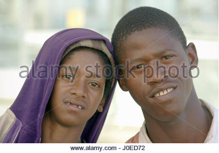 Africa, South Africa, View Of Teenage Boys, One Without Front Teeth. Removing Incisors (By Dentist) Is Carried Out - Stock Photo