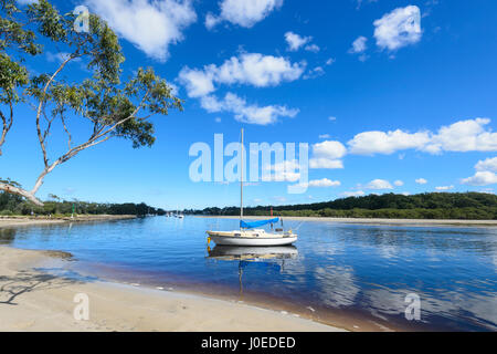 Sailing Boat moored in Currambene Creek, Huskisson, South Coast, New South Wales, NSW, Australia - Stock Photo