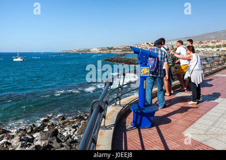 COSTA ADEJE, TENERIFE, CANARY, SPAIN-CIRCA JAN, 2016: Telescope for viewing is on a pedestrian area near the beach - Stock Photo