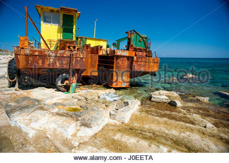 Europe, Greece, Earthmoving Construction Machinery Washed Up Or Parked On Rocks Next To Mediterranean Sea - Stock Photo