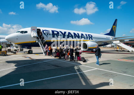 passengers boarding ryanair plane - Stock Photo