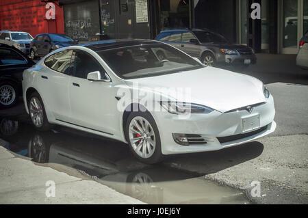 Tesla model s outside the tesla motors showroom in the trendy