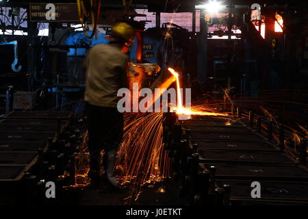 Molten Metal Pouring In Foundry - Stock Photo