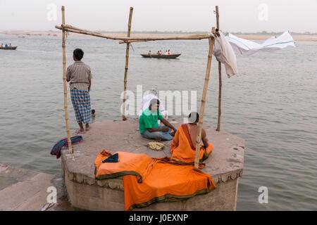 Sadhu sitting on ghat, varanasi, uttar pradesh, india, asia - Stock Photo