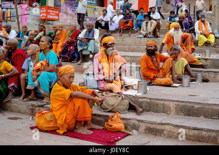 Pilgrims sitting on ghat, varanasi, uttar pradesh, india, asia - Stock Photo