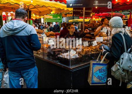 People Shopping At Olivier's Bakery In Borough Market, Southwark, London, England - Stock Photo