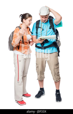 Two lost tourists look at the map on a white background in the studio - Stock Photo
