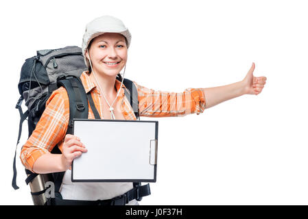 young woman tourist hitchhiking travels with a blank in hands - Stock Photo