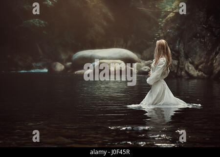 Beautiful victorian woman in mystical stream. Fantasy and fairytale - Stock Photo