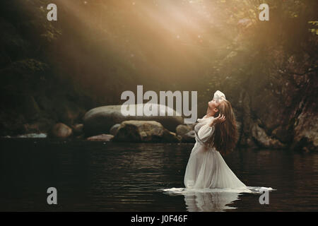 Beautiful young woman in fairy pond. Dark fantasy - Stock Photo