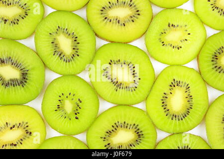 slices of fresh green kiwi fruits as a food background texture - Stock Photo