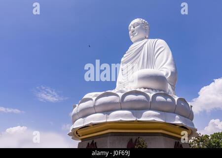 White Buddha Statue at Long Son Pagoda in sunny day at Nha Trang, Vietnam - Stock Photo