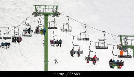 Row of chairlifts. Le Mont Dore ski resort, Auvergne, France - Stock Photo