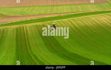 Farming in Europe - Farmer in tractor ploughing in his field in the Auvergne. France - Stock Photo