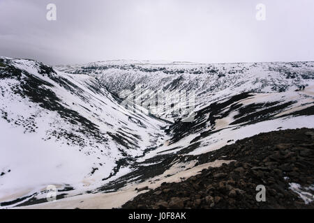 A mountain valley on the trail to the geothermal hot springs of Reykjadalur, near Reykjavik, Iceland - Stock Photo