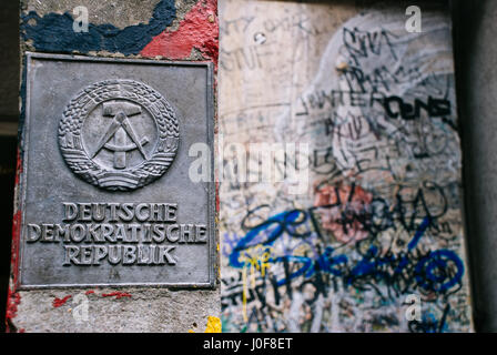 Sign on the Orginal Berlin Wall DDR Sign in Berlin, Germany. - Stock Photo