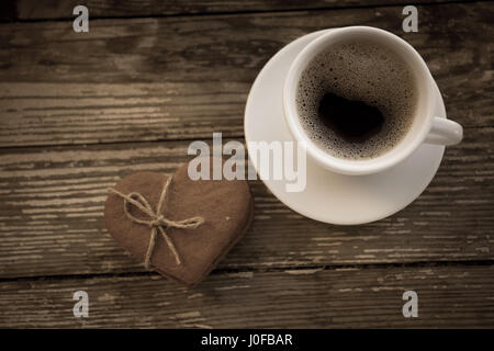 Cup of coffee with Ginger cookies on wooden table. Gingerbread heart-shaped. Coffee break, breakfast. - Stock Photo